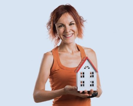 Picture of tenant holding a model house